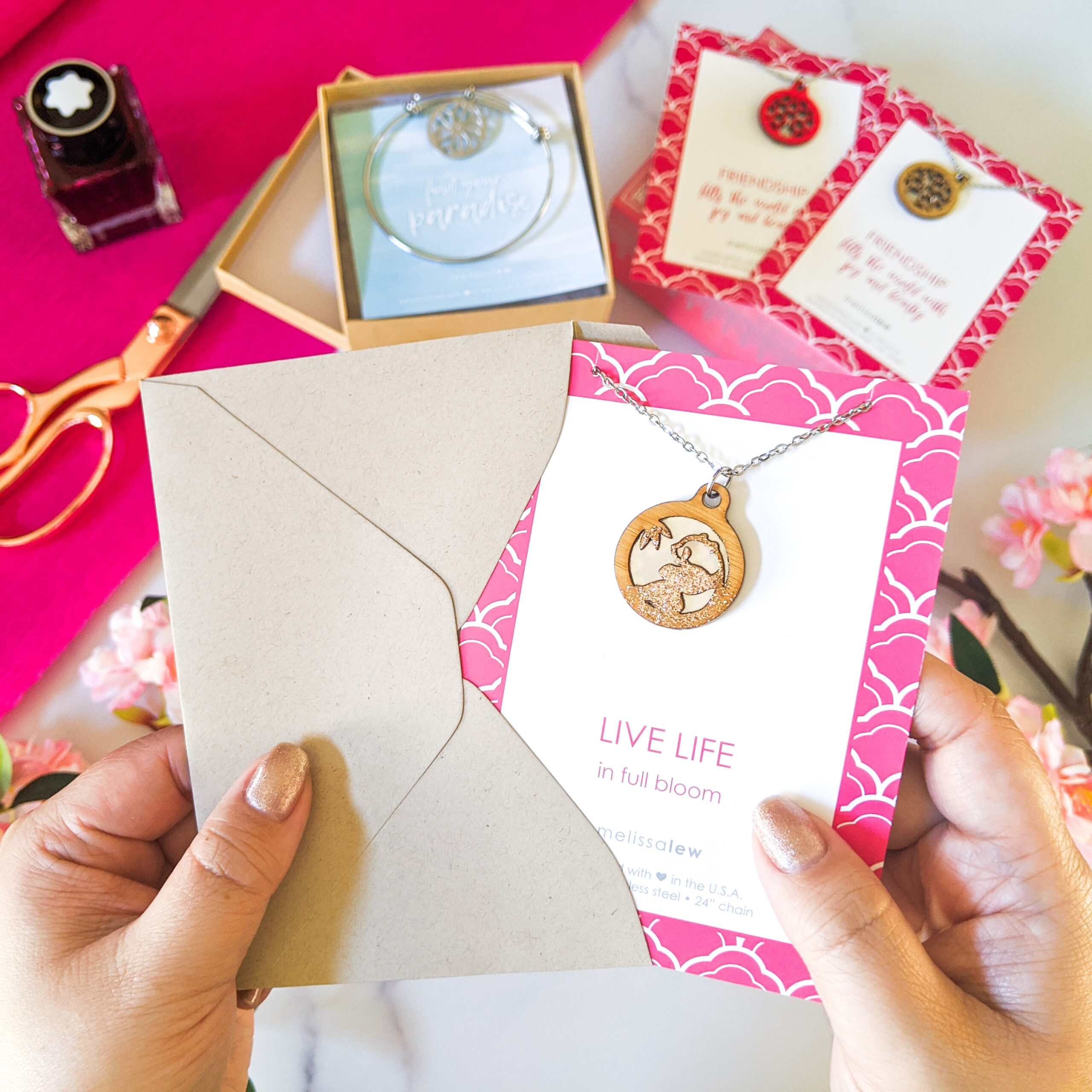 Photo of necklace and card being placed in envelope - gift ready gifts!