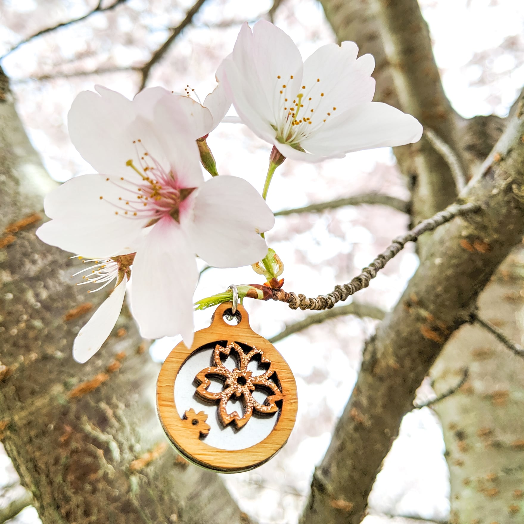 Rose gold double cherry blossom bamboo necklace in tree